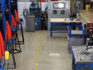 A combination of dots and printed dashes were used to mark the path of the overhead crane.