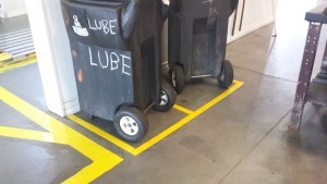 Marking boxes for storing rolling bins helps keep the floor uncluttered.