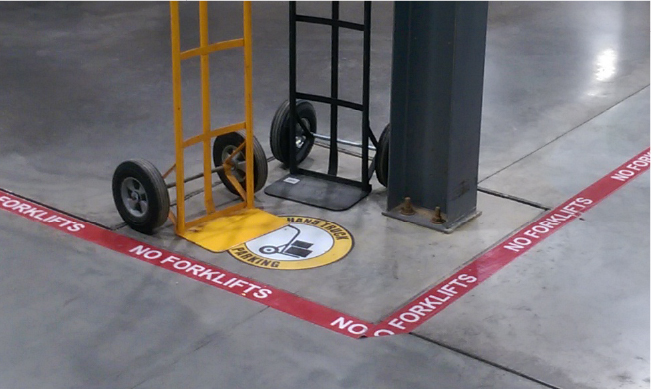 Floor signs and tape can designate space for tools, machinery, and materials
